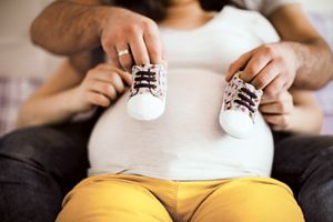 Bump and baby shoes