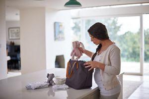pregnant woman organizing her bag