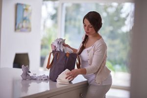 pregnant lady packing bag