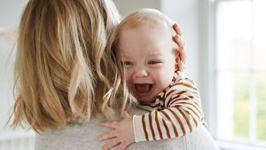 Baby Crying On Mothers Shoulder