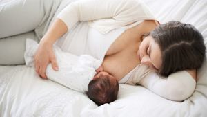 Breastfeeding Baby On Bed