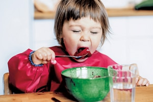 toddler-eating-with-fork.png