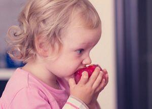 toddler-girl-eating-peach.jpg